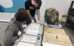 Students in the Block 6 Bias Studies class review documents from the archives.
